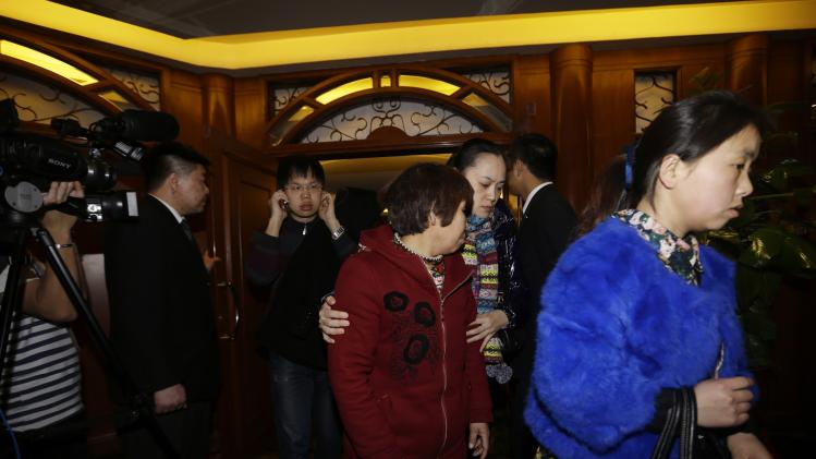 Family members of passengers of Malaysia Airlines flight MH370 leave a rest area in Beijing