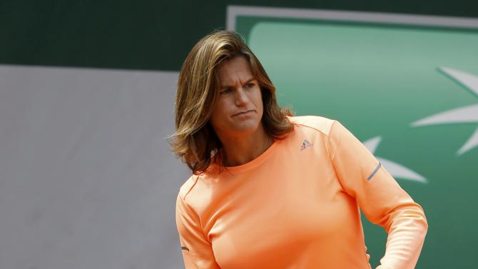 Former tennis player Mauresmo looks at her player Britain's Murray during a training session for the French Open tennis tournament at the Roland Garros stadium in Paris
