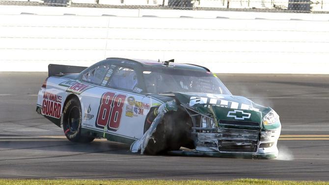 Dale Earnhardt Jr. comes to a stop on the back stretch after he was involved in a crash during the NASCAR Daytona 500 auto race at Daytona International Speedway in Daytona Beach, Fla., Sunday, Feb. 20, 2011. (AP Photo/Josh Balduf)