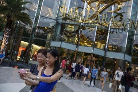 Tourists take a photo of themselves in front of Siam Paragon Department Store in central Bangkok