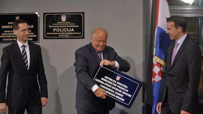 Croatian Finance Minister Linic removes plague at Republic Croatia customs administration next to his Slovenian counterpart Cufer and Hungarian Minister for National Economy Varga, at bordercross in Bregana