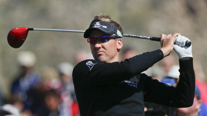 England's Ian Poulter tees off the third hole in the quarterfinal round of play against Steve Stricker at the Match Play Championship golf tournament, Saturday, Feb. 23, 2013, in Marana, Ariz. (AP Photo/Ross D. Franklin)