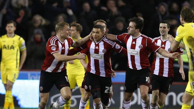Sheffield United's Adams celebrates with team mates after scoring against Tottenham Hotspur during their Capital One Cup semi final second leg soccer match at Bramall Lane in Sheffield