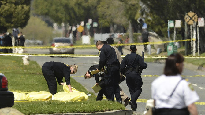 FILE - In this Monday, April 2, 2012 file photo, Oakland Police cover the bodies of victims near Oikos University in Oakland, Calif. A gunman killed seven people in a rampage at the California Christian university. (AP Photo/Noah Berger)