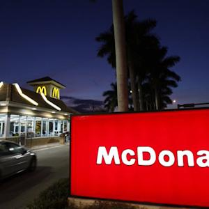 MoneyWatch: McDonalds CEO stepping down; 401K plans hit record highs