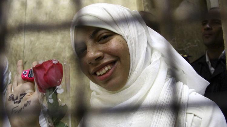 Alaa Osama al-Araky, who was found guilty along with other women and girls of obstructing traffic during a pro-Islamist protest in October, smiles during an appeal hearing at a court in the Mediterranean city of Alexandria