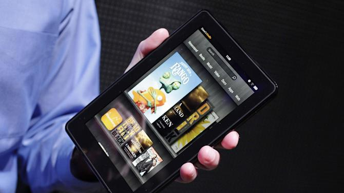 FILE - This Wednesday, Sept. 28, 2011 file photo shows the Kindle Fire  at a news conference in New York. The tablet computer is without a doubt the gift of the year. just like it was last year. But if you resisted the urge in 2011, now is the time to give in. This season's tablets are better all around. Intense competition has kept prices very low, making tablets incredible values compared to smartphones and PCs (AP Photo/Mark Lennihan, File)