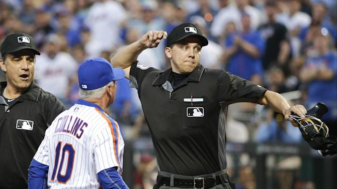 Umpire Adam Hamari, right, throws New York Mets manager Terry Collins (10) out of a baseball game as he argues the ejection of New York Mets' pitcher Noah Syndergaard during the third inning, Saturday, May 28, 2016, in New York. (AP Photo/Frank Franklin II)