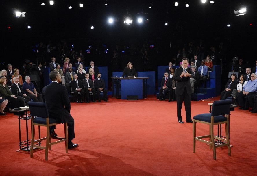 President Barack Obama, left, listens to Republican presidential nominee Mitt Romney during the second presidential debate at Hofstra University, Tuesday, Oct. 16, 2012, in Hempstead, N.Y. (AP Photo/Pool-Michael Reynolds)