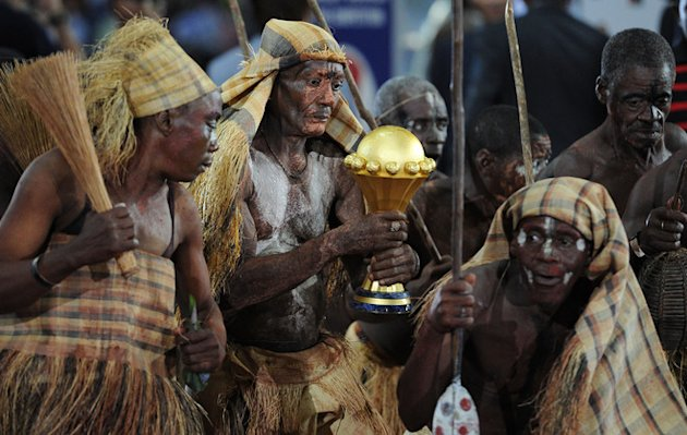 Pygmee Arrive With A Trophy At The End Of The African Cup Of Nations (CAN 2012) Football Match Between Zambia And Ivory AFP/Getty Images