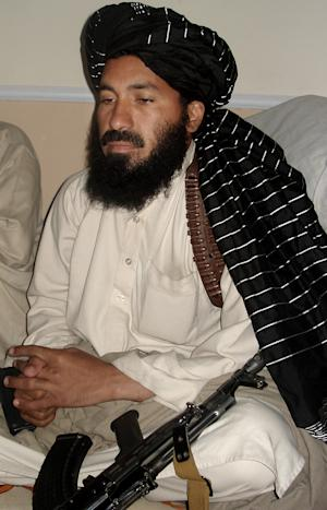 In this April, 20, 2007 photo, Pakistani militant commander Maulvi Nazir meets his associates in South Waziristan near the Afghani border. Pakistani intelligence and government officials say a suicide bomber targeted Nazir, a prominent Pakistani militant commander in the country's northwest, wounding him and killing numbers of people. (AP Photo/Ishtiaq Mahsud)