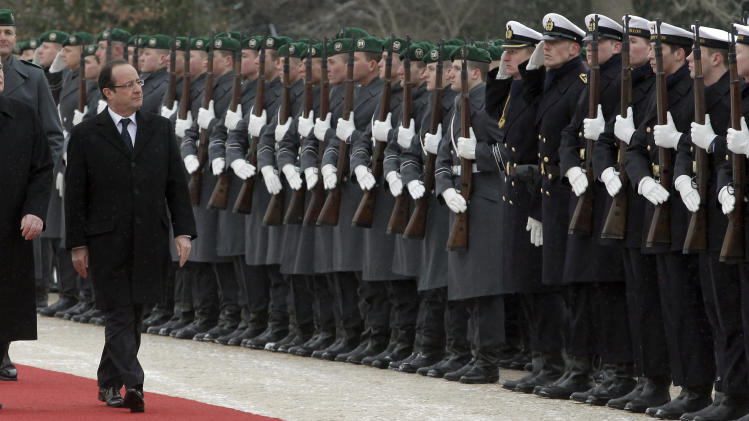 German President Joachim  Gauck, left, welcomes President of France Francois Hollande, right, with military honors at the Bellevue Palace in Berlin, Germany, Tuesday, Jan. 22, 2013. The governments of Germany and France have a one day meeting in Berlin to mark the 50th anniversary of the Elysee Treaty. (AP Photo/Michael Sohn)