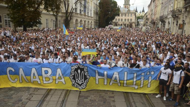 Football supporters from Dynamo Kiev and Shaktar Donetsk take part in a march for a united Ukraine in Lviv