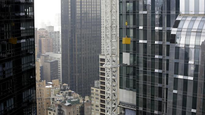 Load from crane in midtown Manhattan is lowered