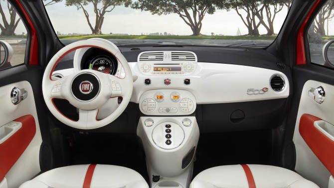 """This undated image provided by Fiat shows the 2013 Fiat 500e mini-car, which will be appearing at the Los Angeles Auto Show this week. The """"500e"""" is the brand's first all-electric model in the U.S. while the """"500L"""" comes with four doors and significantly more room than a regular model. The first 500 hit U.S. showrooms two years ago, promising a stylish and fuel-efficient remake of the 1950s original. But the car needs to boost its allure in the U.S., where sales remain pint-sized compared with the rest of the world. (AP Photo/Fiat)"""