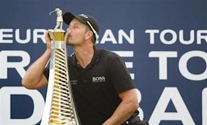 Stenson of Sweden kisses his 2013 Race to Dubai trophy after winning the DP World Tour Championship in Dubai