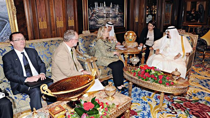 In this photo released by Saudi Press Agency, King Abdullah of Saudi Arabia, right, meets with Secretary of State Hillary Rodham Clinton, 3rd left,  in Riyadh, Saudi Arabia, Friday, March 30, 2012. Clinton sought to work out a unified strategy on the crisis in Syria in talks with Saudi officials on Friday as further violence stymied U.N. efforts to convince Damascus to implement a cease-fire. (AP Photo/HO) EDITORIAL USE ONLY,