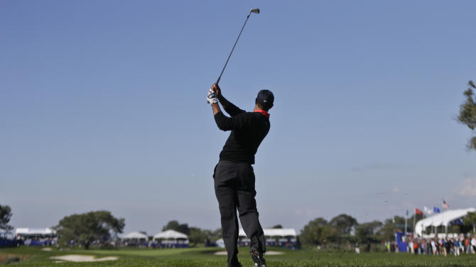 Tiger Woods watches his ball head toward the the 14th green on the South Course at Torrey Pines during the final round of the Farmers Insurance Open golf tournament  Monday, Jan. 28, 2013, in San Diego. The ball came up short and fell into the bunker and Woods bogeyed the hole but won the tournament for the seventh time. (AP Photo/Lenny Ignelzi)