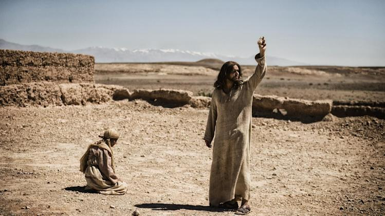 "This publicity image released by History shows Diogo Morcaldo as Jesus, right, in a scene from ""The Bible,"" premiering Sunday, March 3 at 8 p.m. EST on History. (AP Photo/History, Joe Alblas)"
