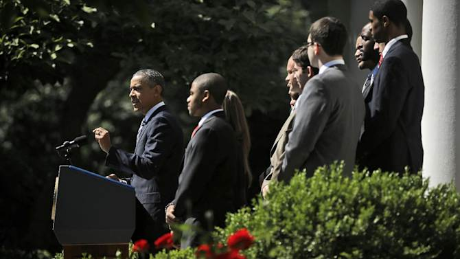 President Barack Obama, joined by college students, speaks in the Rose Garden of the White House, in Washington, Friday, May 31, 2013, where he called on Congress to keep federally subsidized student loans rates from doubling on July 1. (AP Photo/Pablo Martinez Monsivais)