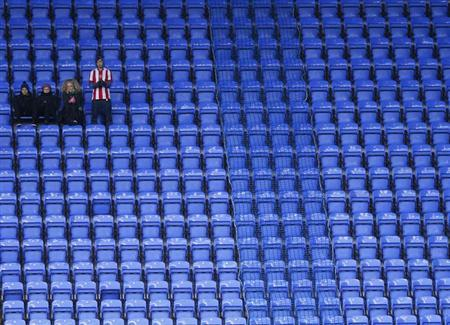 A small group of travelling Sheffield United supporters watch their team play Reading during their English FA Cup fourth round soccer match at the Madejski stadium in Reading, January 26, 2013. REUTER