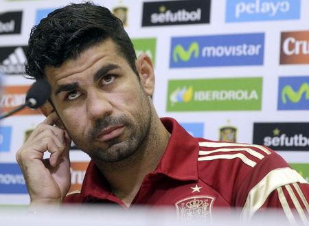 Spain striker Diego Costa gestures at the beginning of a news conference at Soccer City grounds in Las Rozas, near Madrid, Spain