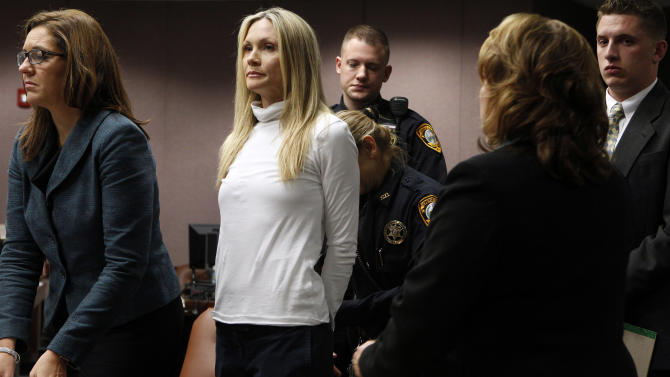 "Former ""Melrose Place"" actress Amy Locane-Bovenizer, 40, second from left, of Hopewell Township, N.J. is taken into custody after jurors in Somerville, N.J.,  convicted her of vehicular homicide.   At left is her attorney Ellen Torregrossa-O'Connor.      (AP Photo/Robert Sciarrino, pool)"