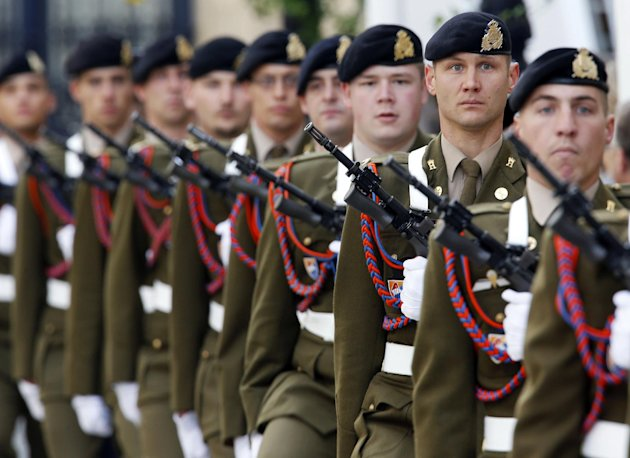 Soldiers stand guard near the Palace during the royal wedding in Luxembourg, Saturday, Oct. 20, 2012. Royalty from Europe, the Middle East and Japan have arrived in the tiny country to celebrate the wedding ceremonies of the heir to the throne Prince Guillaume to Belgian Countess Stephanie de Lannoy. (AP Photo/Michael Probst)