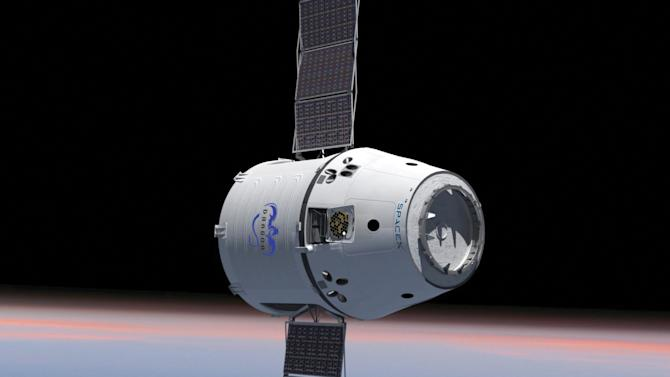 This computer generated image provided by SpaceX shows their Dragon spacecraft with solar panels deployed. The world's first private supply ship flew tantalizingly close to the International Space Station on Thursday, May 24, 2012 but did not stop, completing a critical test in advance of the actual docking scheduled for Friday, May 25, 2012. (AP Photo/SpaceX)