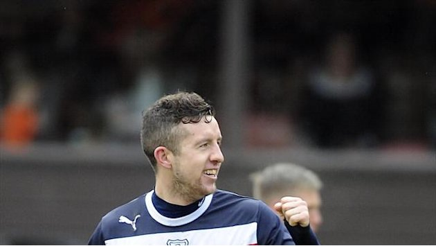 Scottish Football - Dundee stay alive with win over Hearts