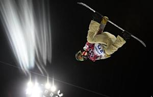White of the U.S. performs a jump during a training session for the snowboard men's halfpipe competition at the 2014 Sochi Winter Olympic Games in Rosa Khutor