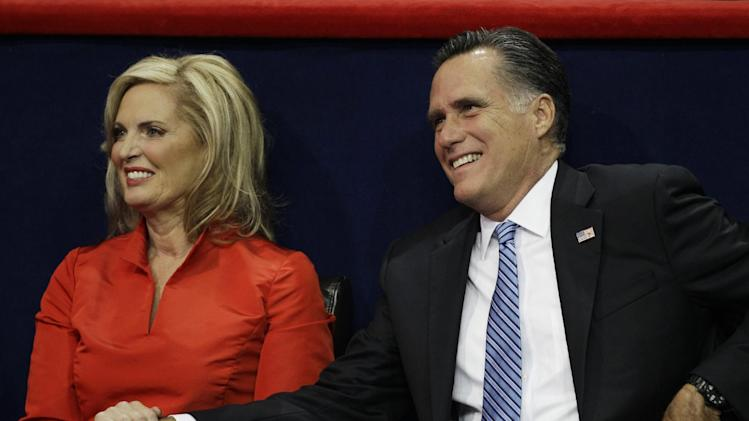 U.S. Republican presidential nominee Mitt Romney sits his wife Ann after she addressed the Republican National Convention in Tampa, Fla., on Tuesday, Aug. 28, 2012.(AP Photo/Charlie Neibergall)