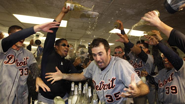 FILE - In this Oct. 11, 2012 file photo, Detroit Tigers' Justin Verlander (35) is drenched with sparkling wine by teammates at the end of Game 5 of the American League division baseball series in Oakland, Calif. Verlander has agreed to a five-year contract covering 2015-19. (AP Photo/Ben Margot, File)