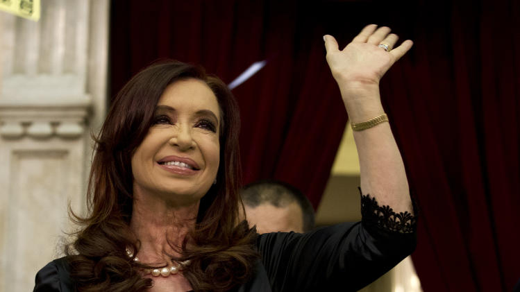 Argentina's President Cristina Fernandez waves to supporters after entering the chamber of the Argentine National Congress in Buenos Aires, Argentina, Friday, March 1, 2013. Fernandez was on hand to inaugurate the 2013 opening legislative session. (AP Photo/Victor R. Caivano)