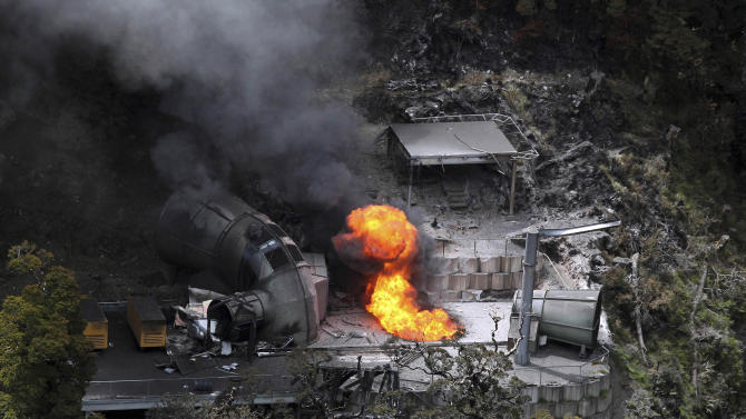 FILE - In this Nov. 30, 2010 file photo, flames burn from a ventilation shaft above the Pike River mine which has fatally trapped 29 miners and contractors in Greymouth, New Zealand. New Zealand coal mining company Pike River Coal ignored 21 warnings that methane had accumulated to explosive levels before an explosion killed the 29 workers two years ago, an investigation released Monday, Nov. 5, 2012, concluded. (AP Photo/NZPA, Iain McGregor, File)  NEW ZEALAND OUT