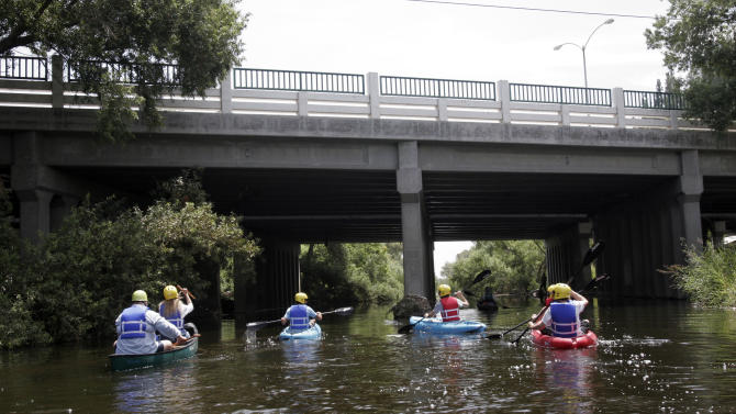 This Aug. 12, 2011 photo shows kayakers paddling down the Los Angeles River.  For the first time ever a six week pilot program sponsored by the LA Conservation Corps will allow about 280 people to kayak one of the few stretches that actually look like a river in the Sepulveda basin. The effort was a decade in the making and required half a dozen local and federal agencies to sign off on the project.  (AP Photo/Noaki Schwartz)