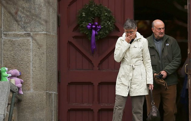 Newtown residents seek solace in church and prepare to bury their dead