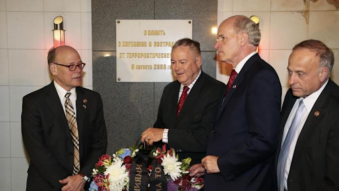 From left, U.S. Congressmen, Steve Cohen (D-Tenn.), Dana Rohrabacher (R-Calif.), Bill Keating (D-Mass.) and Steve King (R-Iowa.), lay a wreath at the site of a terrorist attack in 2000 in the underground street passage in Pushkin Square in downtown Moscow, Wednesday, May 29, 2013. A U.S. Congressional delegation is spending a week in Russia meeting high-level government and security officials to investigate whether more could have been done to prevent last month's Boston Marathon bombings. (AP Photo/Ivan Sekretarev)