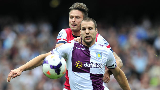 Arsenal's French striker Olivier Giroud vies with Aston Villa's Dutch defender Ron Vlaar (right) during a Premier League match at the Emirates stadium in north London on August 17, 2013