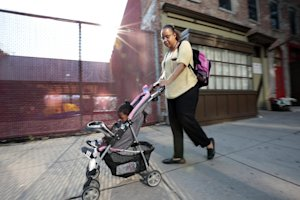Ke'sha Scrivner, right, heads to a subway Metro stop …
