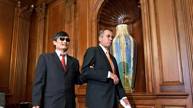 Blind Chinese dissident Chen Guangcheng is escorted by House Speake John Boehner of Ohio, for a bipartisan event with House Minority Leader Nancy Pelosi, D-Calif., and other members of Congress, Wednesday, Aug. 1, 2012, on Capitol Hill in Washington. He made international headlines in April when he escaped from house arrest in China and sought refuge in the U.S. embassy in Beijing.  (AP Photo/J. Scott Applewhite)