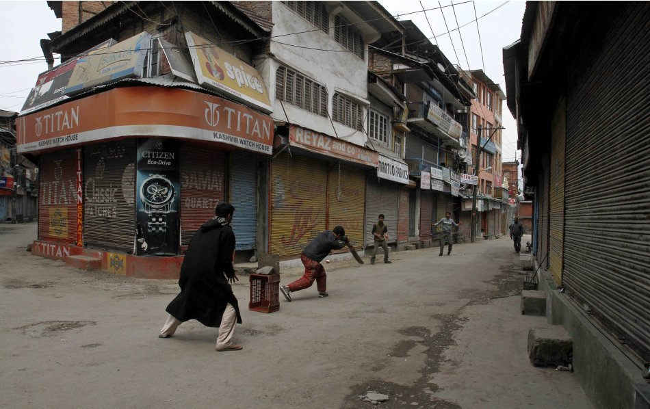 Kashmiri boys play cricket at a closed market area during a strike in Srinagar, India, Saturday, April 9, 2011. Shops and schools in Indian-controlled Kashmir are closed to protest the blast that kill