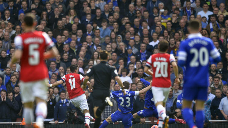 Arsenal's Ozil scores a goal against Everton during their English FA Cup quarter final soccer match at the Emirates stadium in London