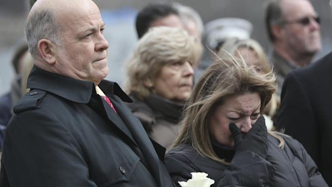 "Family members of the those killed in the first terrorist attack on the World Trade Center in New York observe a moment of silence Tuesday, Feb. 26, 2013, during a ceremony to honor the six people who died in the attack 20 years ago. The moment of silence was observed at 12:18 p.m., the time when a truck bomb was detonated below the north tower. The victims' names were read by family members before bagpipers played ""Amazing Grace."" About 50 people attended the ceremony, held at the 9/11 memorial, where the twin towers were destroyed eight years later. (AP Photo/Mary Altaffer)"