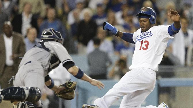 Dodgers beat Yankees 3-2 on Ellis' RBI single