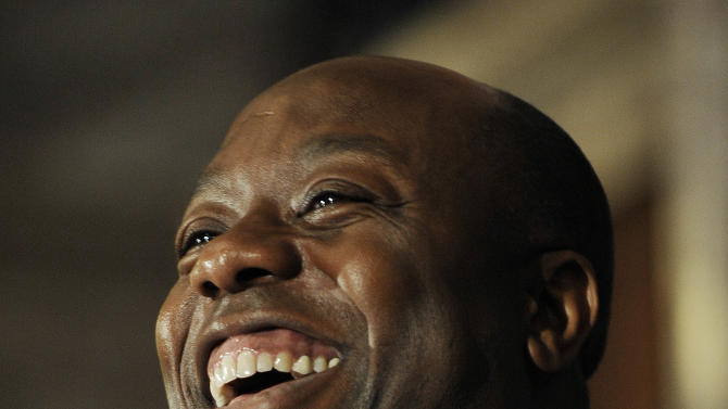 Unites States Rep. Tim Scott laughs during a press conference announcing him as U.S. Sen. Jim DeMint's replacement in the U.S. Senate at the South Carolina Statehouse on Monday, Dec. 17, 2012, in Columbia, S.C. South Carolina Gov. Nikki Haley picked U.S. Rep. Tim Scott to be the state's next U.S. senator Monday, making him the only black Republican in Congress and the South's first black Republican senator since Reconstruction. (AP Photo/Rainier Ehrhardt)