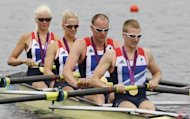 Britain's Pamela Relph, Naomi Riches, Davis Smith, James Roe and Lily van den Broecke row off with their gold medals after winning the LTA mixed coxed four in Eton Dorney
