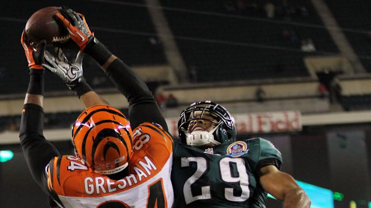 Bengals tight end Jermaine Gresham goes up for the ball as Eagles safety Nate Allen tries to prevent the catch. Philadelphia Eagles fell to the Cincinnati Bengals 34-13 at Lincoln Financial Field Thursday, Dec. 13, 2012. (AP Photo/The News Journal, Daniel Sato)