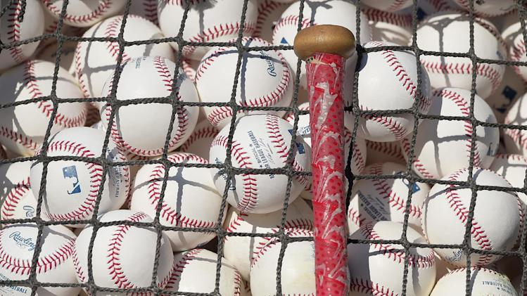A Chicago Cubs bat sits against a bag of baseballs prior to a baseball game Los Angeles Dodgers, Friday, Aug. 1, 2014, in Los Angeles. (AP Photo/Mark J. Terrill)