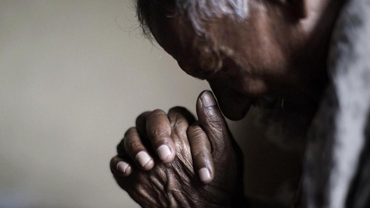 An elderly Pakistani Christian man, prays during a Mass on Good Friday in a church in Islamabad, Pakistan, Friday, March 29, 2013. Christians around the world are marking the Easter holy week. (AP Photo/Muhammed Muheisen)
